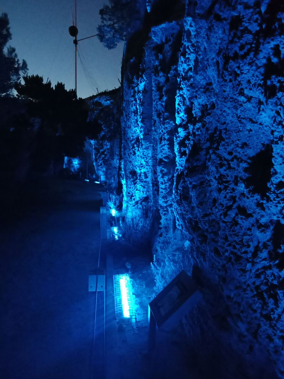 Rock wall and blue lights