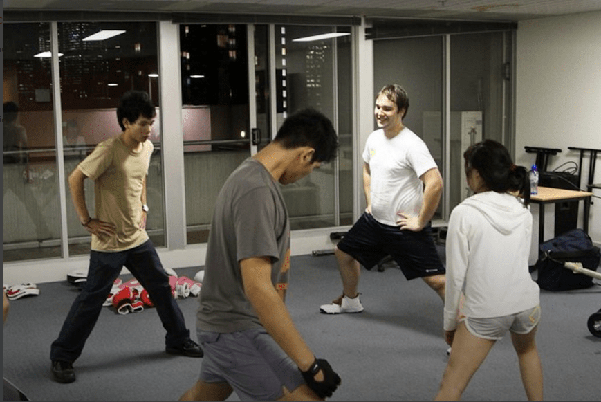 Andrew leading an exercise class, standing lunges